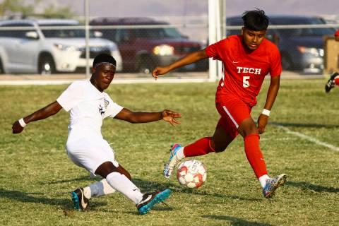 Spring Valley's Piyo Mulonda (11) moves the ball around Southeast Career Tech's Carlos Rivera ( ...
