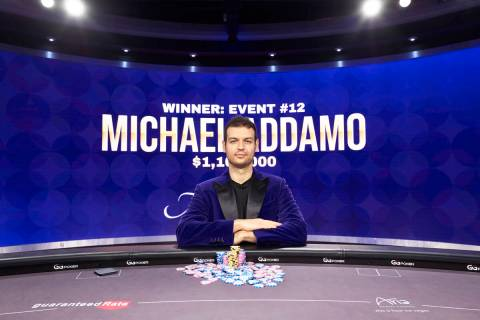 Michael Addamo wears the purple jacket of the Poker Masters champion after winning the final ev ...