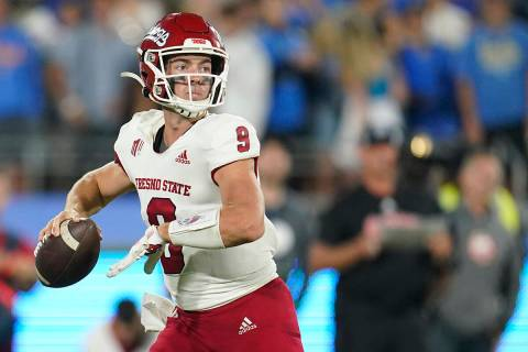 Fresno State quarterback Jake Haener throws during the first half of an NCAA college football g ...