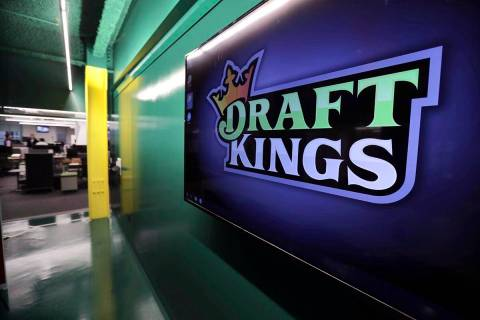 FILE - In this May 2, 2019, file photo, the DraftKings logo is displayed at the sports betting ...