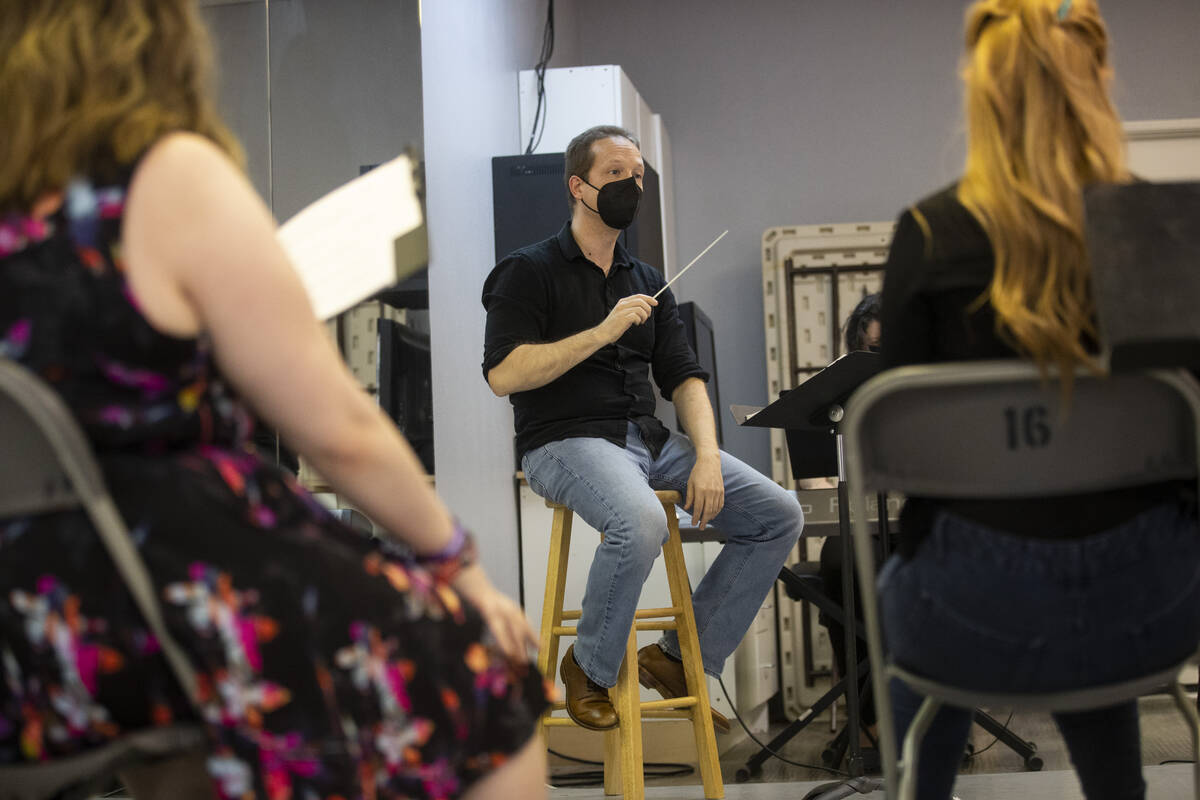 """Conductor Joshua Horsch, center, during an opera rehearsal of """"The Ghosts of Gatsby"""" ..."""