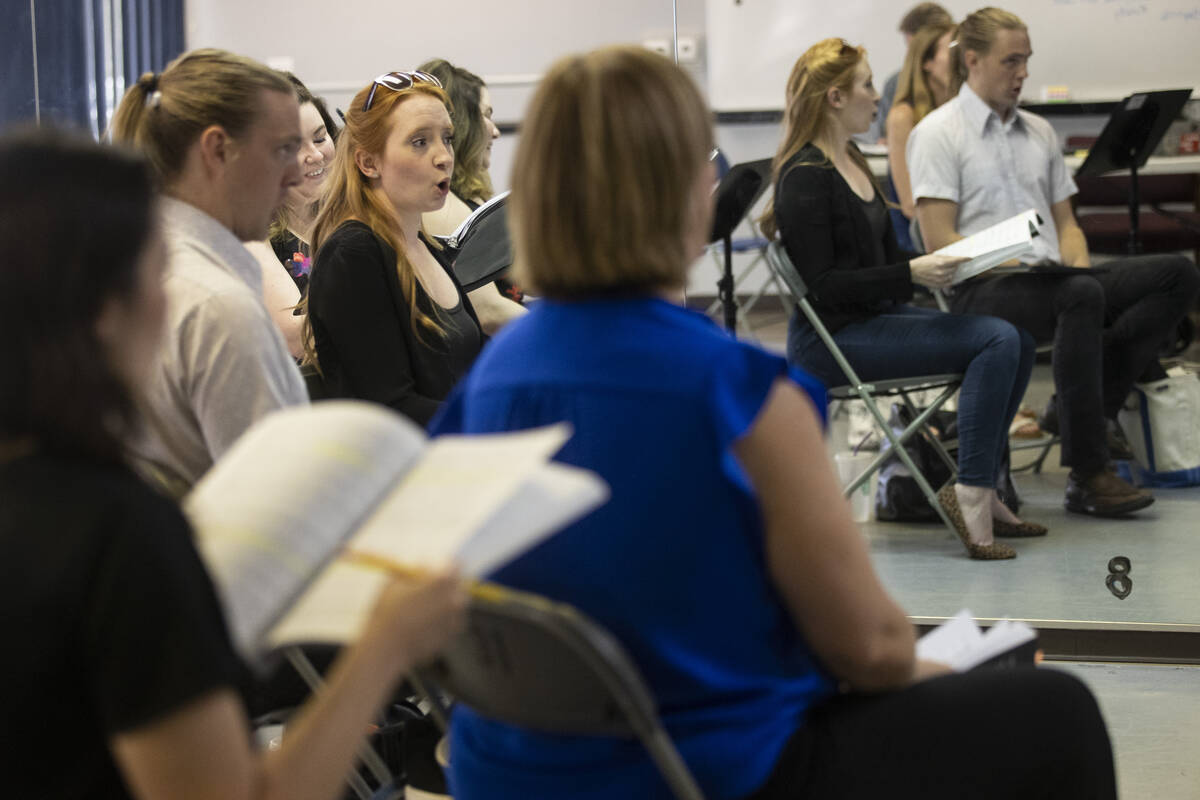 """Kayla Wilkens, center, sings during an opera rehearsal of """"The Ghosts of Gatsby"""" at t ..."""