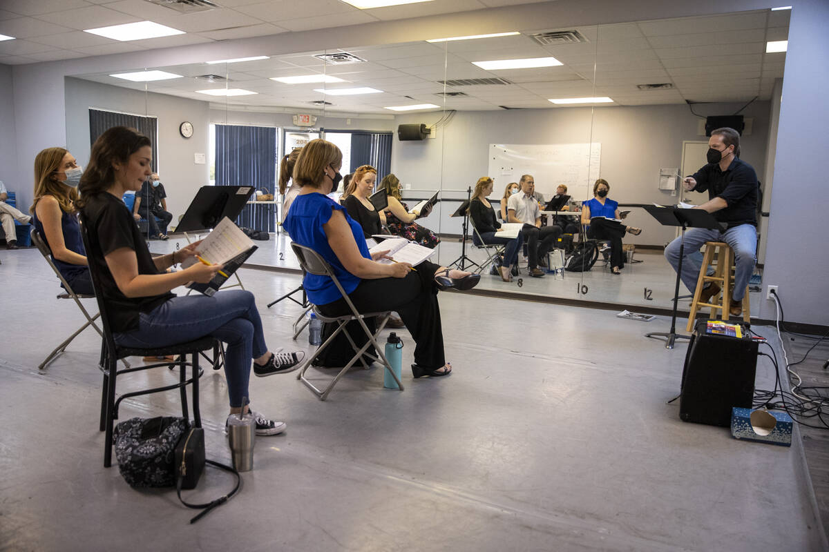 """Conductor Joshua Horsch, right, leads an opera rehearsal of """"The Ghosts of Gatsby"""" at ..."""