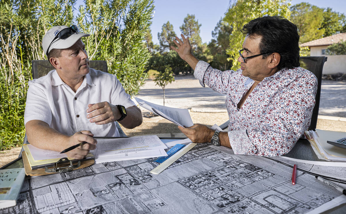Biagio Guerra, right, and Jerry Pavelec discuss their opposition to a proposed housing developm ...