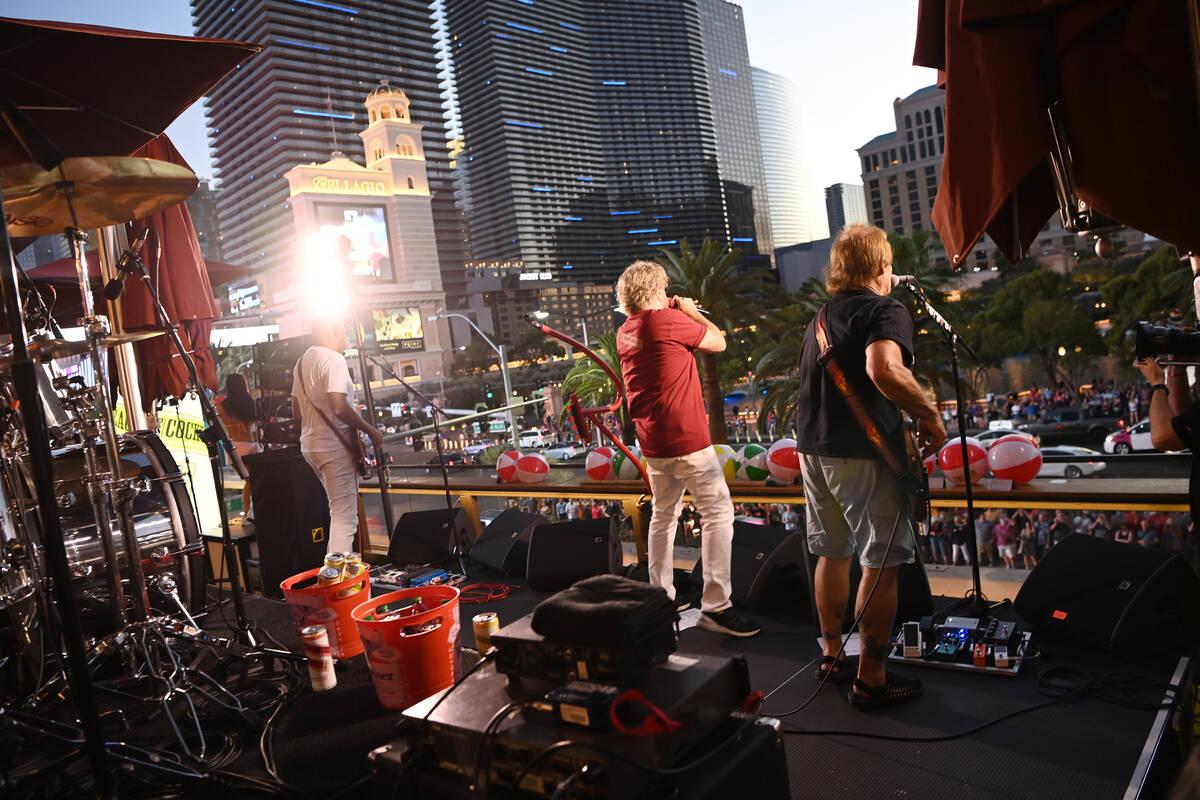 Guitarist Vic Johnson, Sammy Hagar and Michael Anthony perform at the launch of Sammy Beach Bar ...