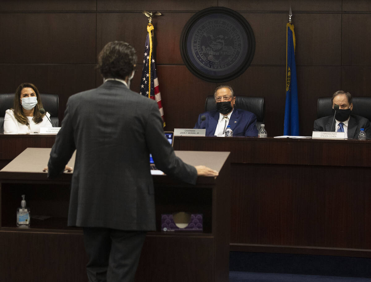 John Moran, second right, chairman of the Nevada Gaming Commission, Commissioners Rosa Solis-Ra ...