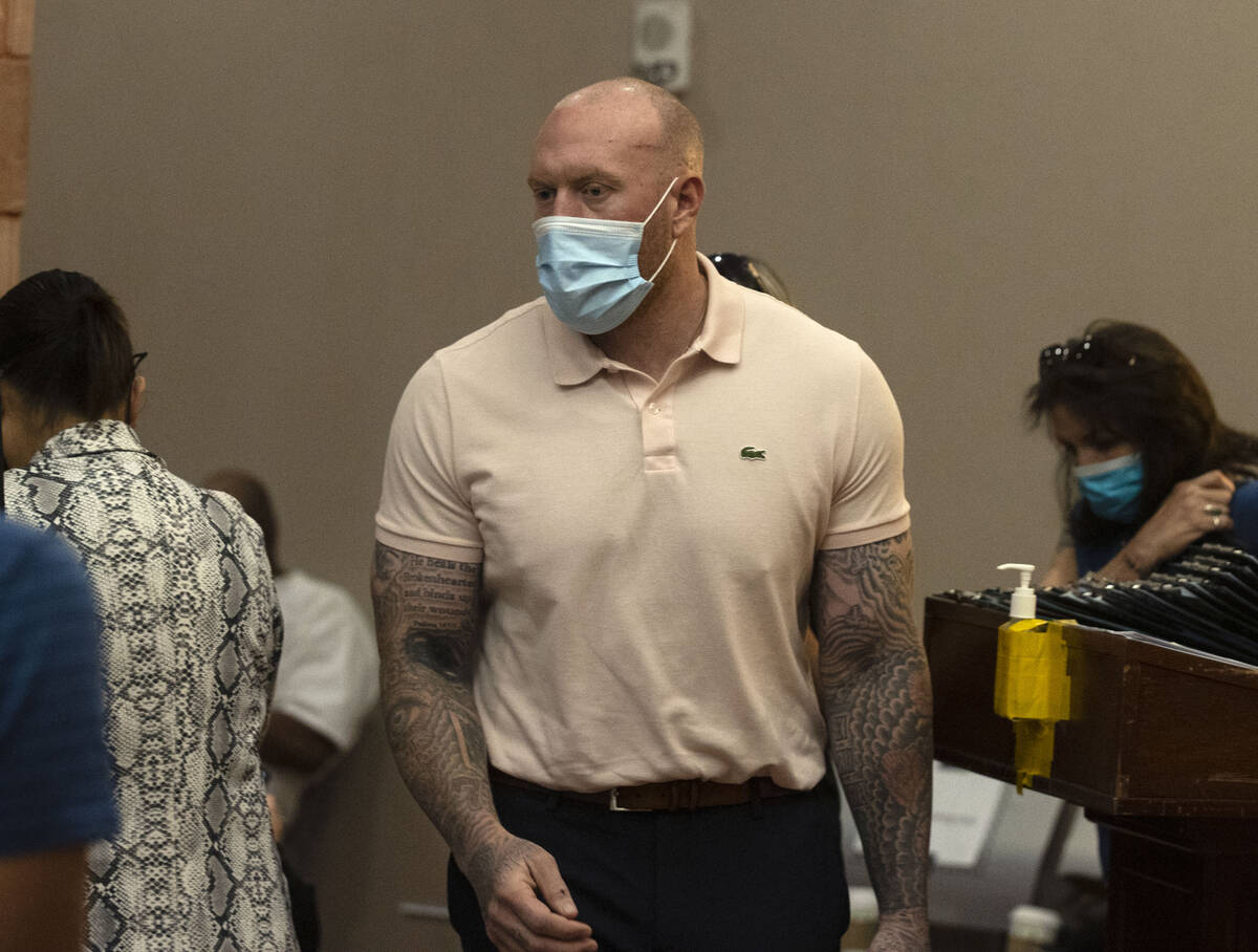 New Haven, Conn., police officer Robert Ferraro, charged in a fatal DUI crash, arrives at the R ...