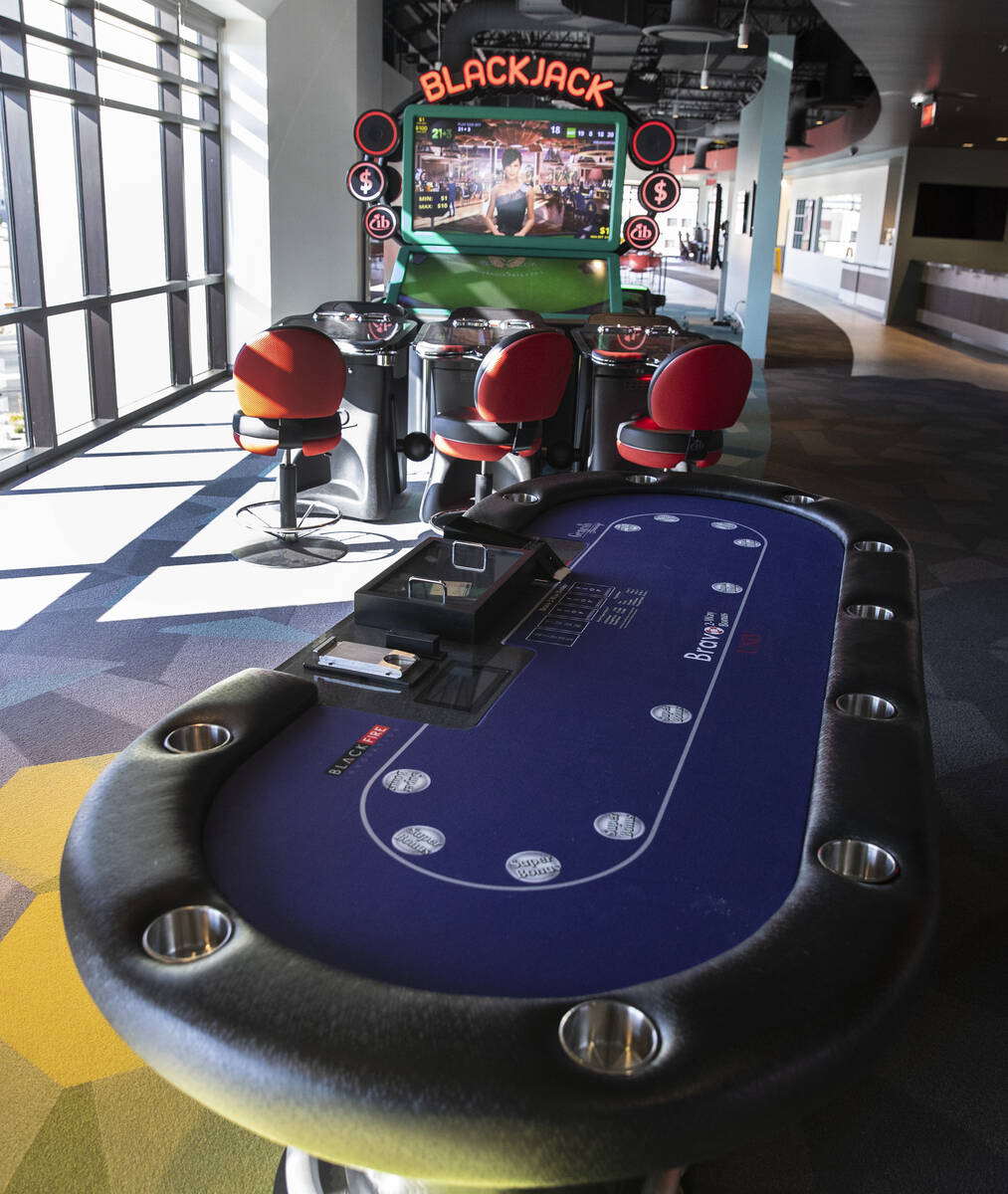 A gaming table and a video blackjack machine are displayed at the Black Fire Innovation center ...