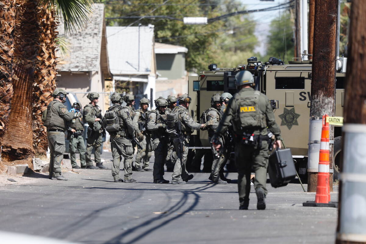 SWAT team arrives near the intersection of 10th Street and Lewis Avenue, Tuesday, Sept. 21, 202 ...