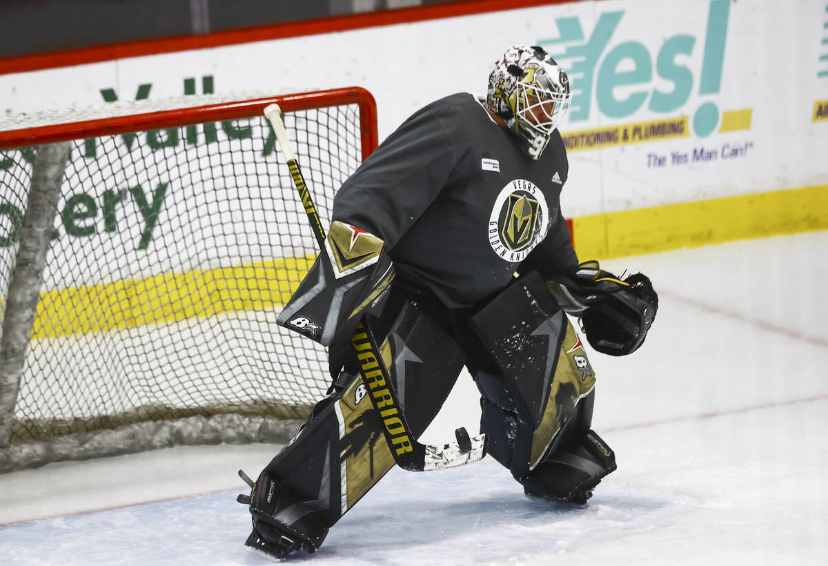 Golden Knights goaltender Robin Lehner defends the net during the first on-ice day of training ...