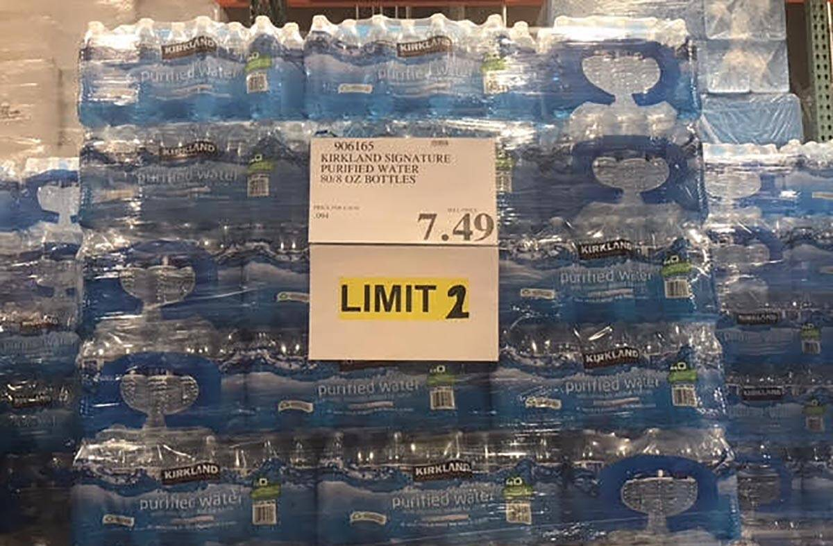 Customers can only purchase two packages of water at Costco's Summerlin store per a sign observ ...