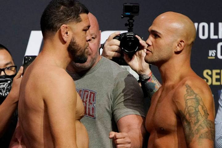 Nick Diaz, left, and Robbie Lawler pose during a ceremonial weigh-in for a UFC 266 mixed martia ...