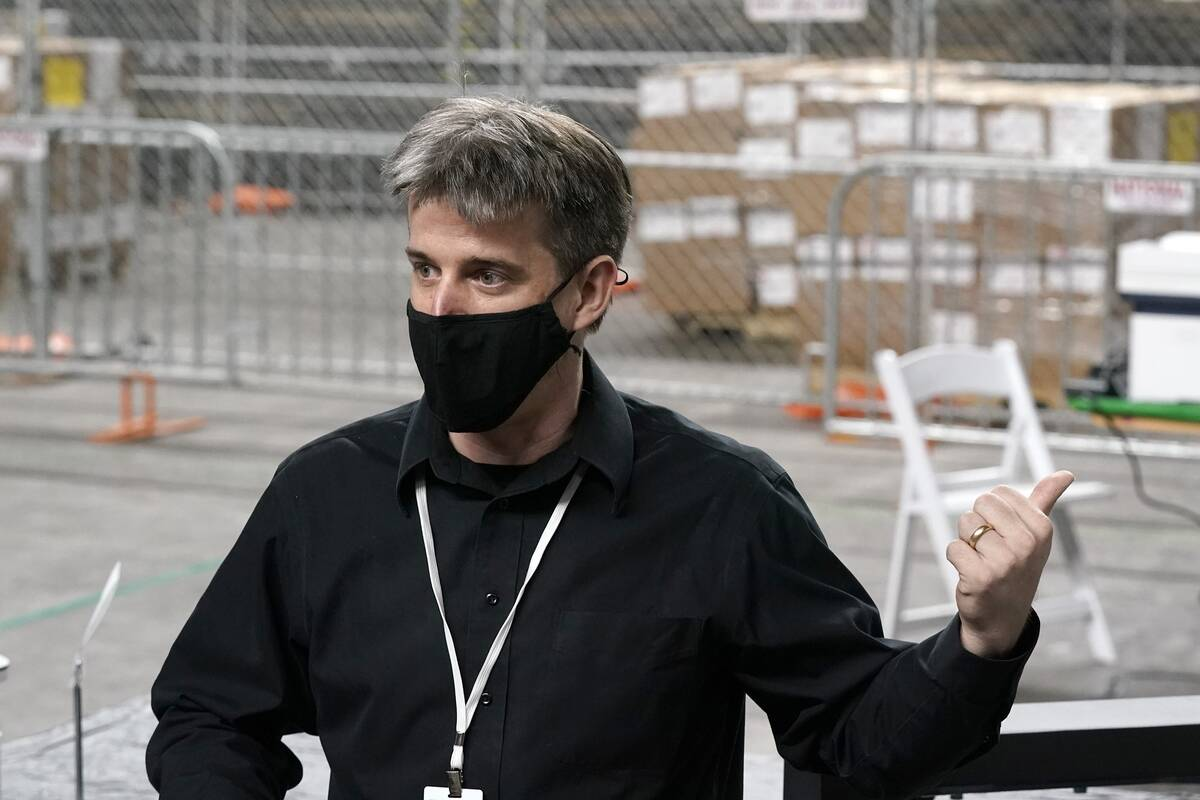 In this April 22, 2021, file photo, Cyber Ninjas owner Doug Logan, a Florida-based consultancy, ...