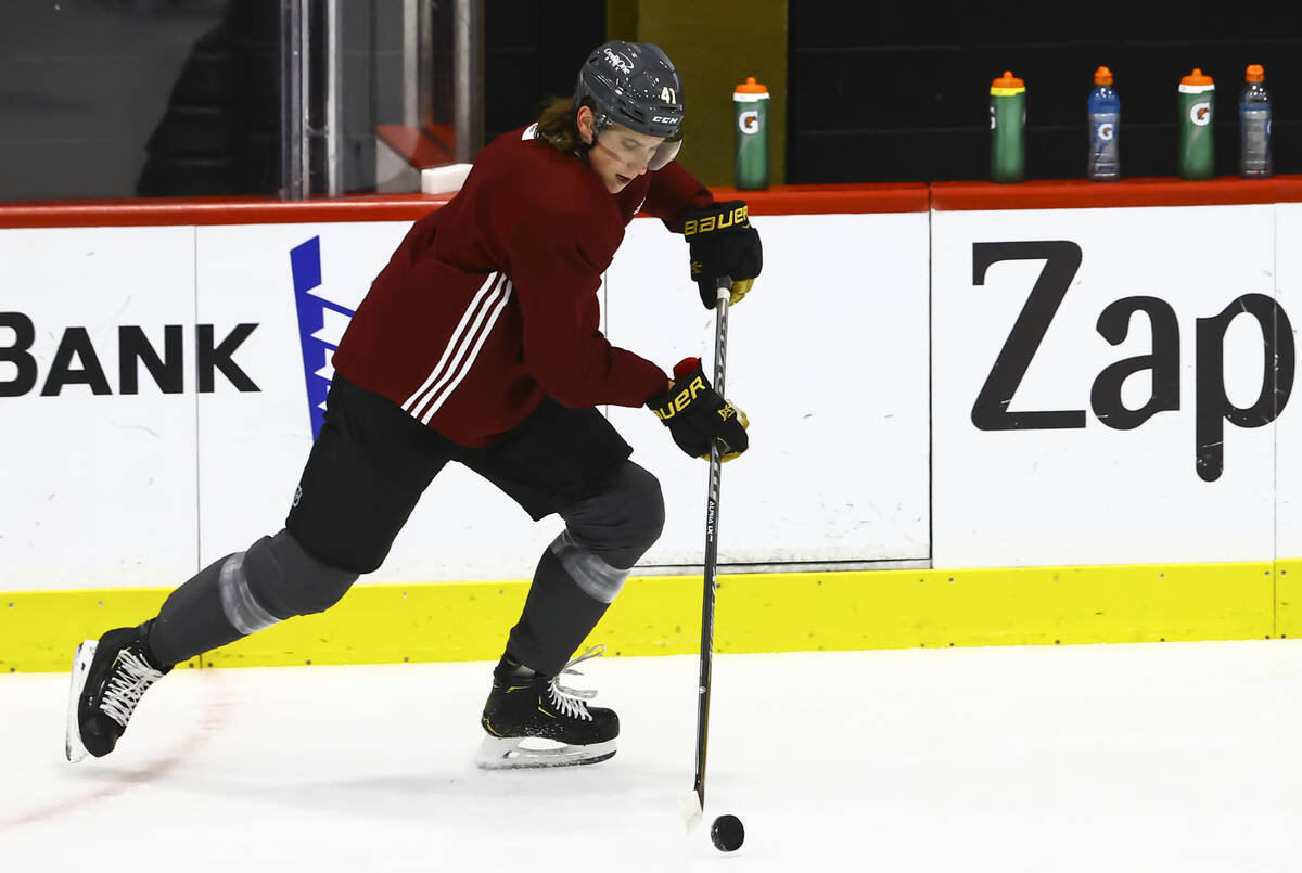 Golden Knights' Nolan Patrick (41) skates with the puck during the first on-ice day of training ...