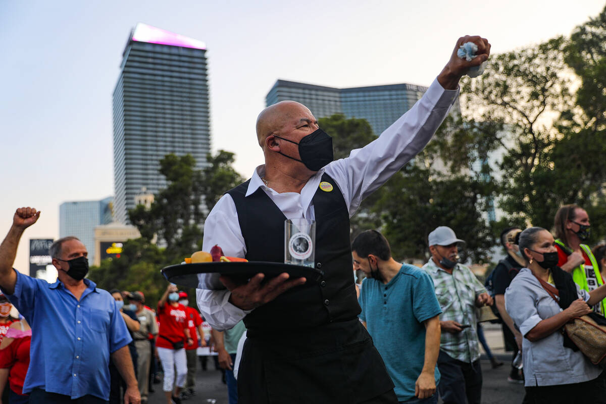 Jose Rivera chants as he marches with other members of the Culinary Workers Union Local 226 to ...