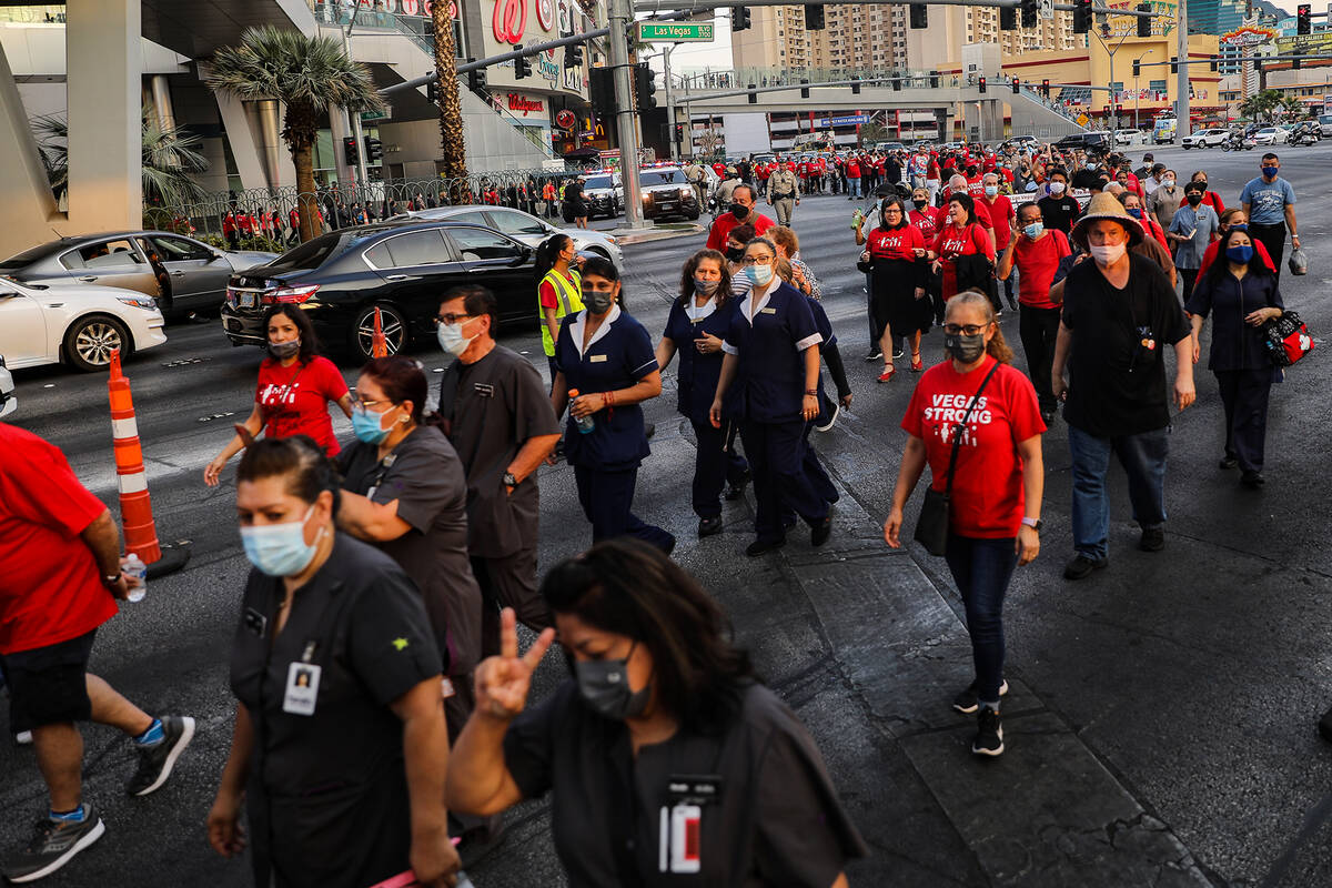 Members and supporters of the Culinary Workers Union Local 226 march the Strip to bring attenti ...