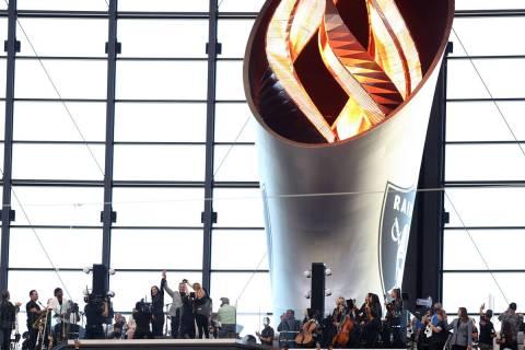 Former Nevada Gov. Brian Sandoval lights the Al Davis Memorial Torch before an NFL football gam ...