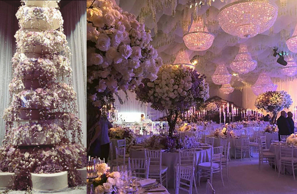 The wedding cake, left, and a lavish floral display are seen at the Kelley Fertitta-Tyler Nemir ...