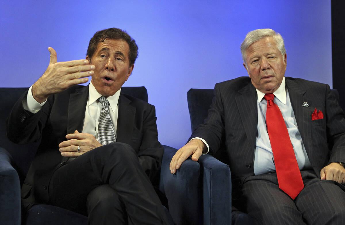 This Dec. 5, 2011 photo shows casino mogul Steve Wynn, left, gesturing as New England Patriots ...