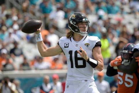 Jacksonville Jaguars quarterback Trevor Lawrence (16) throws a pass during the first half of an ...