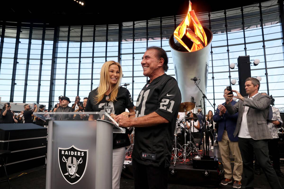 Steve Wynn lights the Al Davis Memorial Torch with his wife Andrea Hissom before the Raiders ta ...
