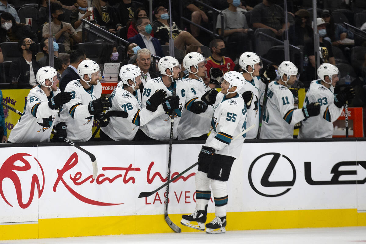 Sharks center Alexander Chmelevski (55) is congratulated by his team after scoring a goal on th ...