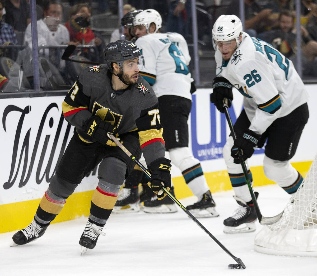 Golden Knights forward Gage Quinney (72) skates with the puck with Sharks center Jasper Weather ...