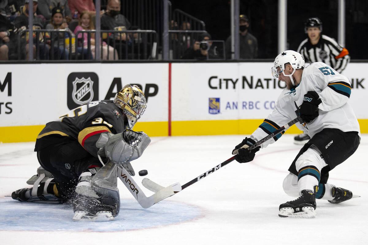 Golden Knights goaltender Logan Thompson (36) saves a shot by Sharks forward Adam Raska (57) du ...