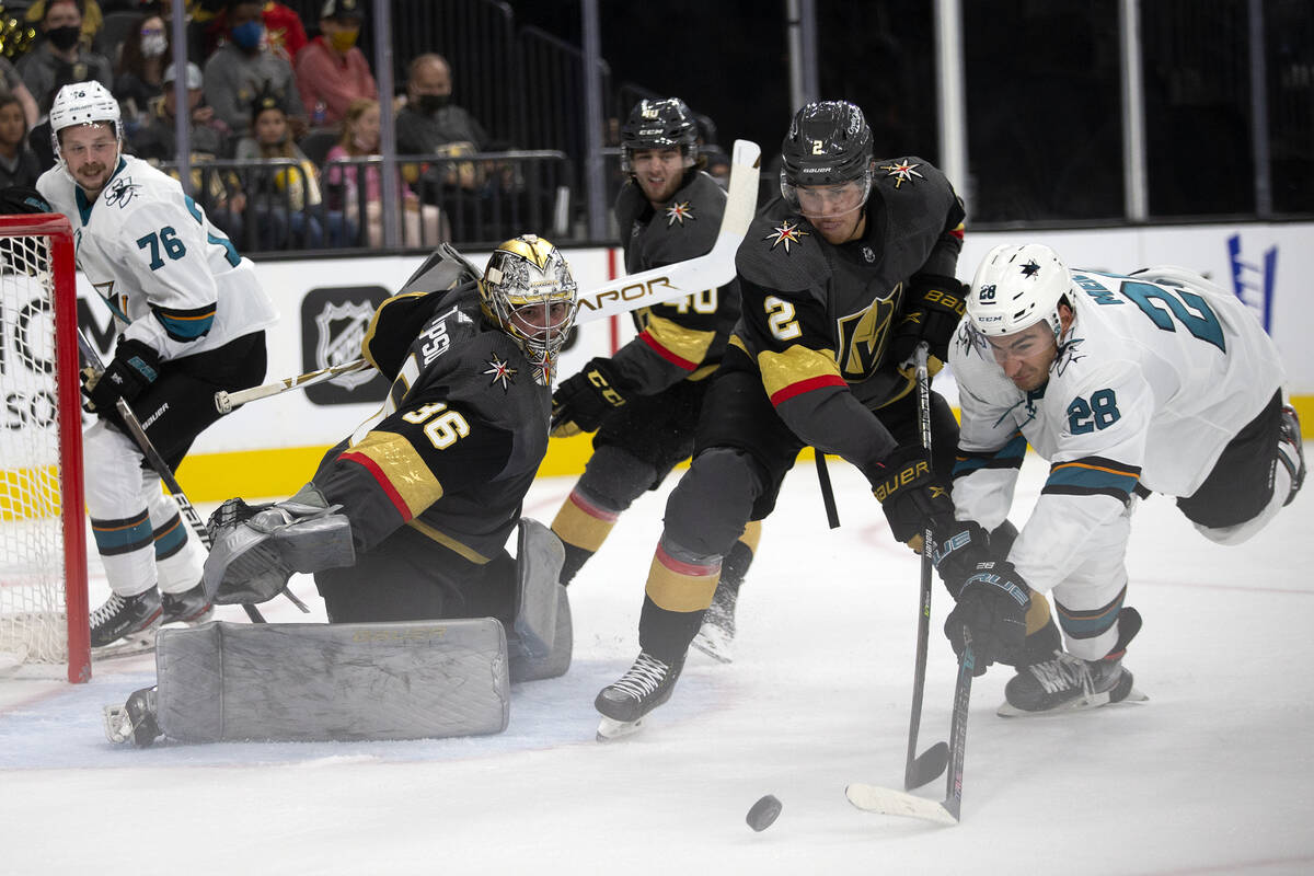 Golden Knights goaltender Logan Thompson (36) prepares to save a shot by Sharks right wing Timo ...