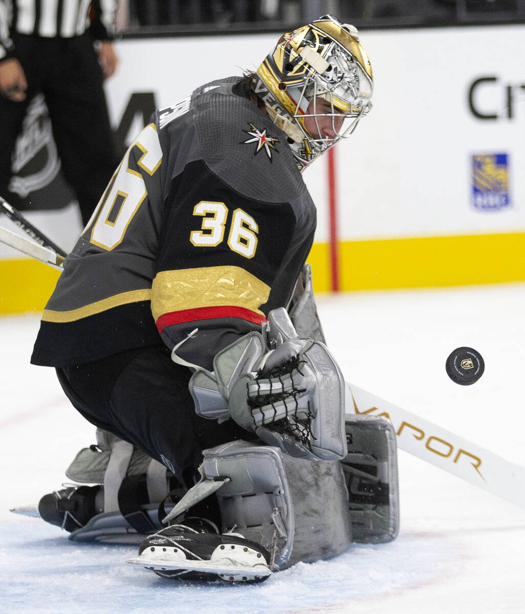 Golden Knights goaltender Logan Thompson (36) saves a shot by the Sharks during the second peri ...