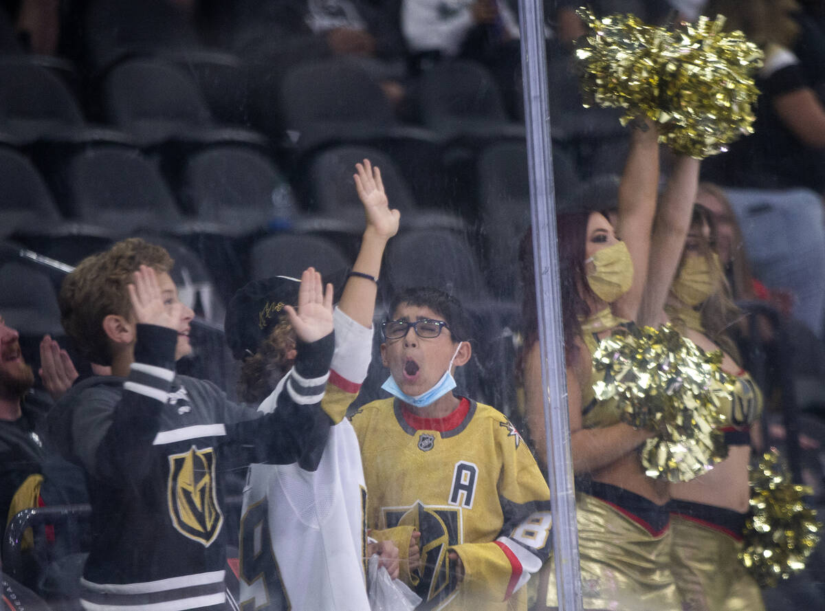 Fans cheer during a shootout following a preseason NHL hockey game between the Golden Knights a ...