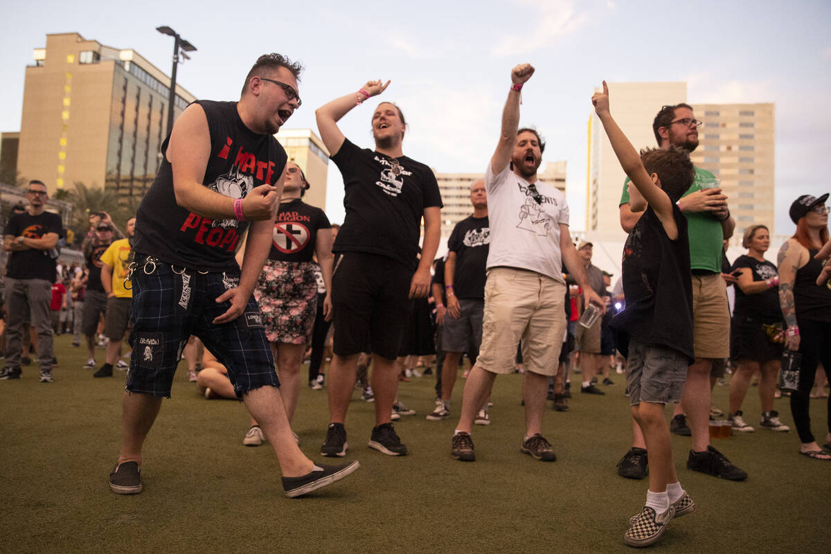 People dance to Leftover Crack performing during the Punk Rock Bowling Music Festival at the Do ...