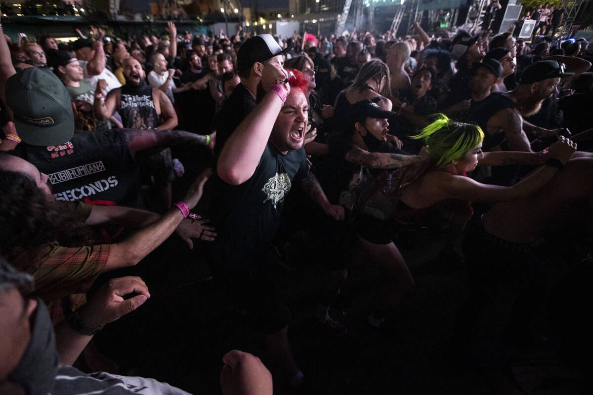 People mosh during a performance by Leftover Crack at the Punk Rock Bowling Music Festival at t ...