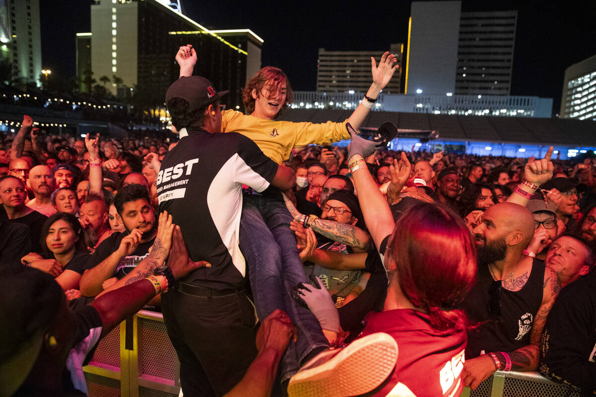 A person crowd surfs during a performance by Circle Jerks at the Punk Rock Bowling Music Festiv ...