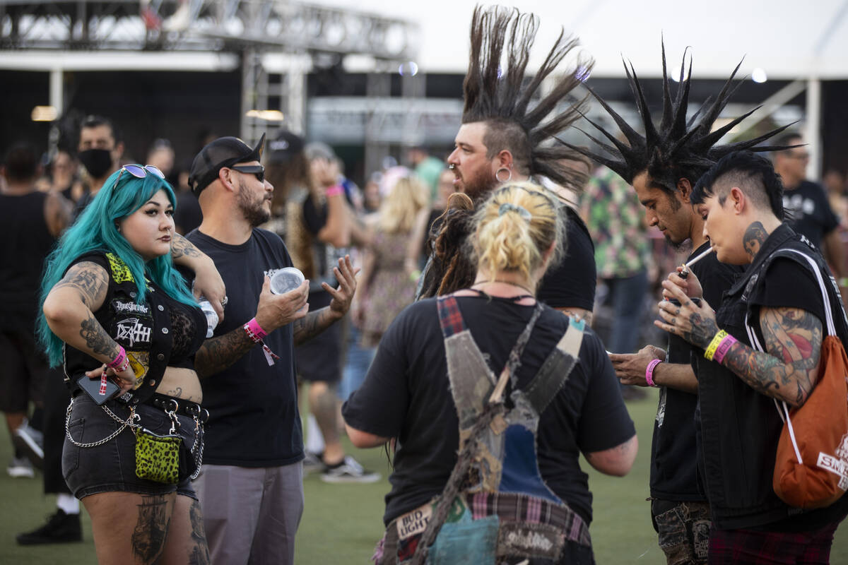 People attend the Punk Rock Bowling Music Festival at the Downtown Las Vegas Events Center in L ...