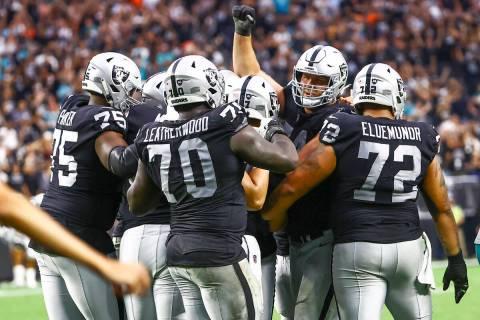 Raiders celebrate around kicker Daniel Carlson (2) after his game-winning field goal in overtim ...