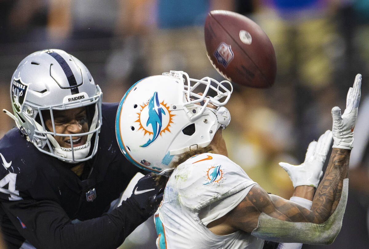 Las Vegas Raiders defensive back Johnathan Abram (24) breaks up a pass intended for Miami Dolph ...