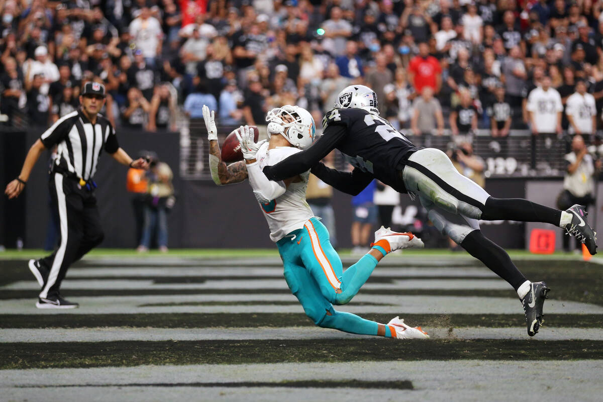 Miami Dolphins wide receiver Will Fuller (3) misses a catch under pressure from Las Vegas Raide ...