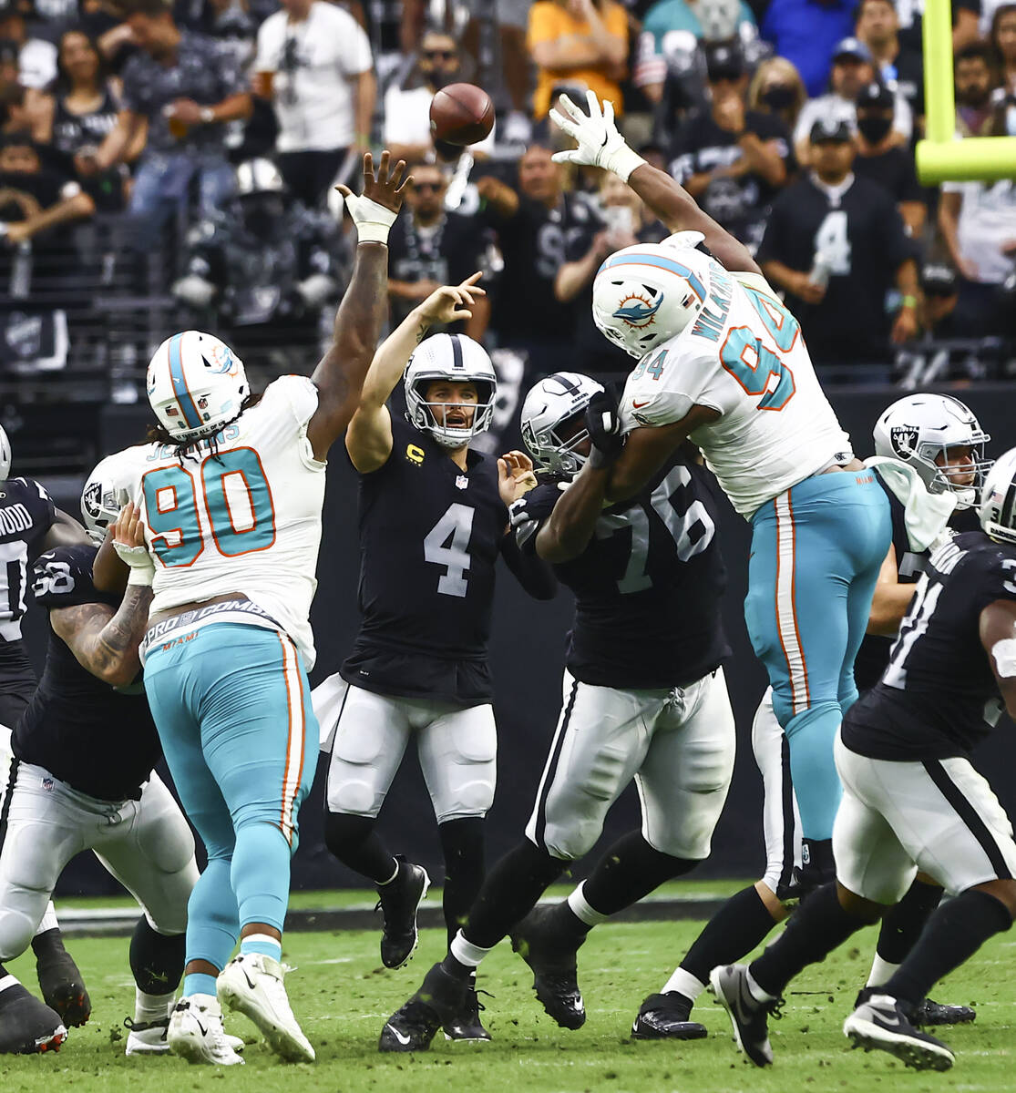 Raiders quarterback Derek Carr (4) throws a pass during the second half of NFL game against the ...