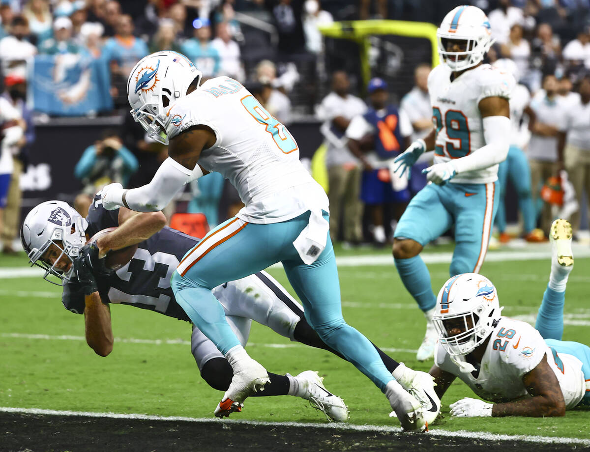 Raiders wide receiver Hunter Renfrow (13) scores a touchdown in front of Miami Dolphins free sa ...