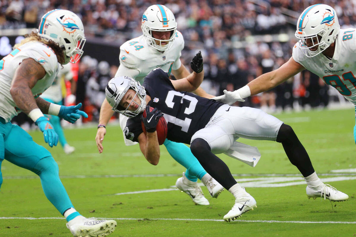 Las Vegas Raiders wide receiver Hunter Renfrow (13) drops to the ground during a punt to avoid ...