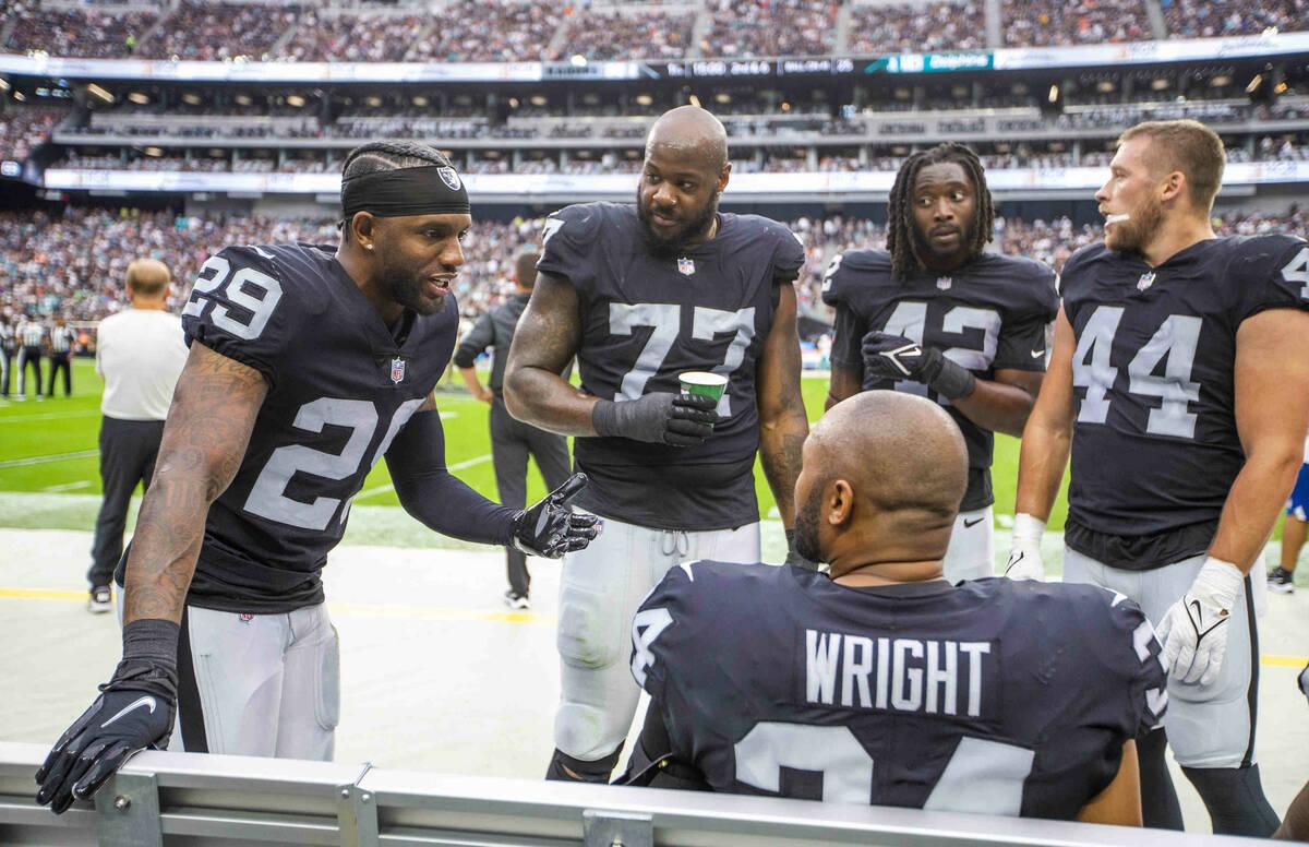 Las Vegas Raiders cornerback Casey Hayward (29) talks about his safety to teammates versus the ...
