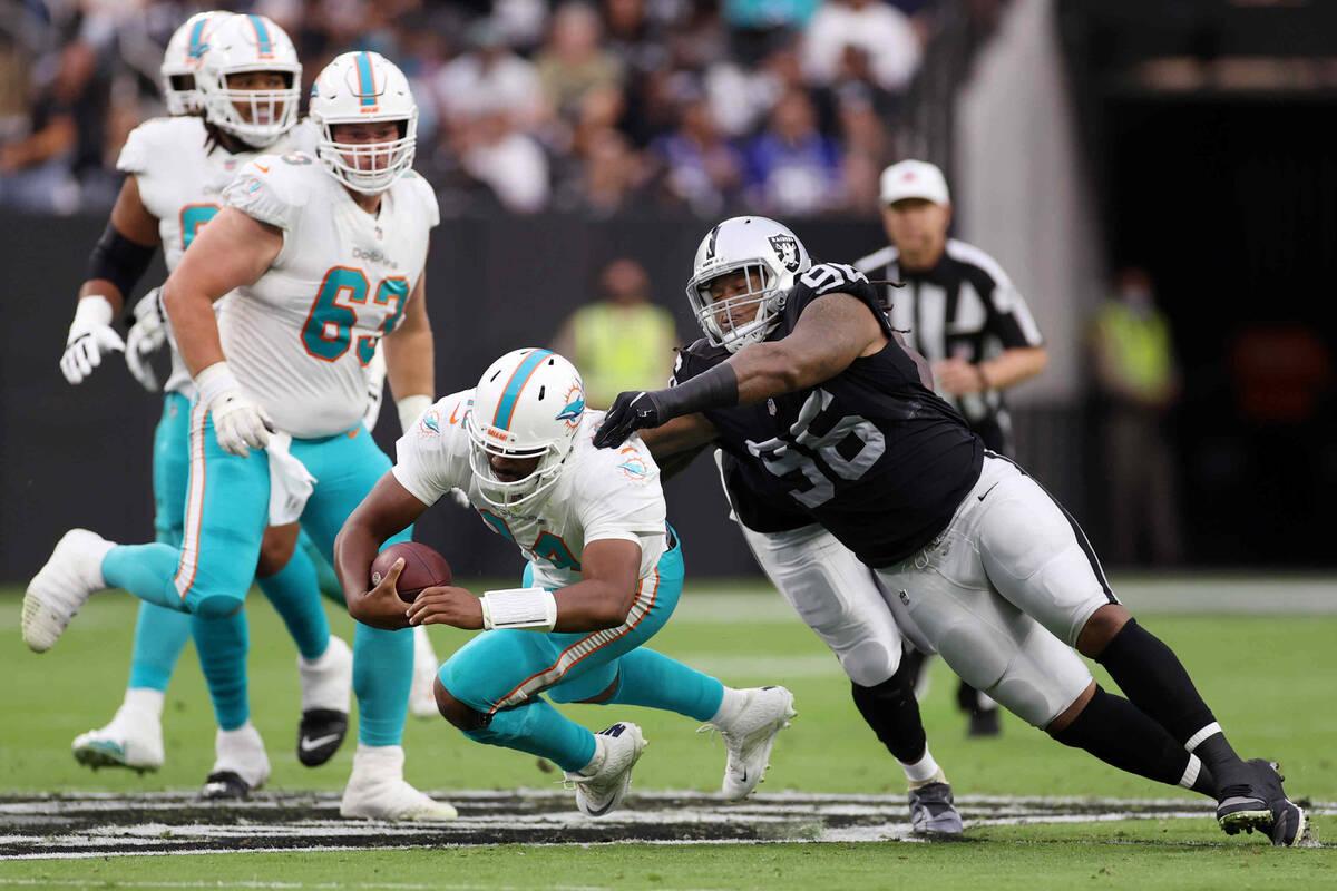Las Vegas Raiders defensive tackle Darius Philon (96) tackles Miami Dolphins quarterback Jacoby ...