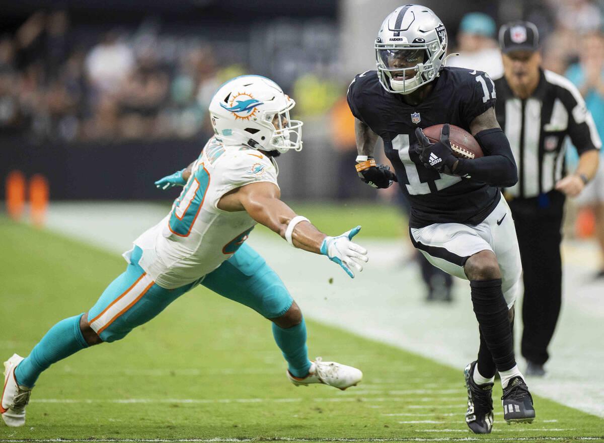 Las Vegas Raiders wide receiver Henry Ruggs III (11) breaks down the sideline past Miami Dolphi ...