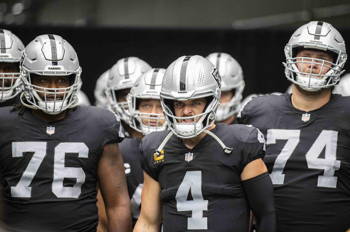Las Vegas Raiders quarterback Derek Carr (4) gets ready to lead his team on the field before th ...