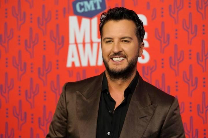 Luke Bryan arrives at the CMT Music Awards at the Bridgestone Arena in Nashville, Tenn., in Jun ...