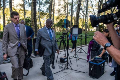 Attorney Deveraux Cannick, representing R&B star R. Kelly, center, arrives at Brooklyn Federal ...