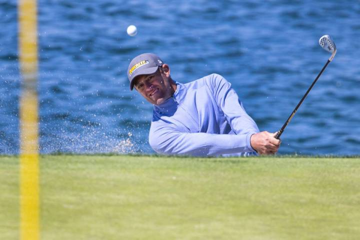 Jamie Arnold of Sydney, Australia, hits out of a bunker on the fourth hole during the first ro ...
