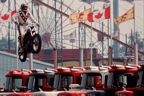 FILE - In this Aug. 20, 1974, file photo Daredevil motorcyclist Evel Knievel sails over 7 Mack ...