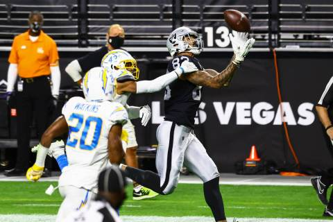 Raiders tight end Darren Waller (83) makes the catch on the way to score a touchdown past Los A ...
